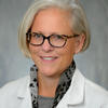 Image of Dr. Kuhns in white coat